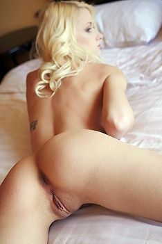 Naked Blond Girl Posing In